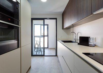 Interiorismo ático Tren de Rota diseño cocina
